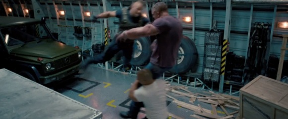 The Rock clotheslining a guy off of Vin Diesel's shoulders...OK, this does look pretty cool.